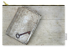 Carry-all Pouch featuring the photograph Rusty Key On The Old Tattered Book by Michal Boubin