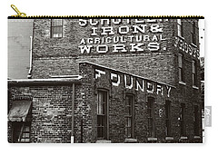 Carry-all Pouch featuring the photograph Schuyler Iron Building Black And White by Trina Ansel