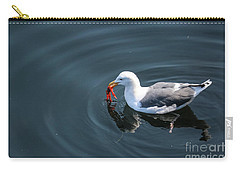 Carry-all Pouch featuring the photograph Seagull Feasting On Crab by Suzanne Luft