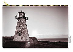 Carry-all Pouch featuring the photograph Setting Sun At Cape Tryon Lighthouse by Chris Bordeleau