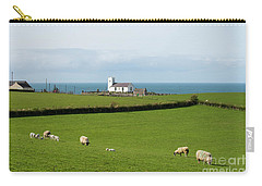 Carry-all Pouch featuring the photograph Sheep Grazing On Irish Coastline by Juli Scalzi