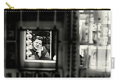 Carry-all Pouch featuring the photograph Shopkeeper At Night by John Williams