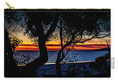 Silhouettes Over Blue Water Carry-all Pouch