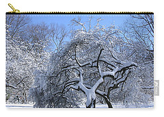 Carry-all Pouch featuring the photograph Snow-covered Sunlit Apple Trees by Byron Varvarigos