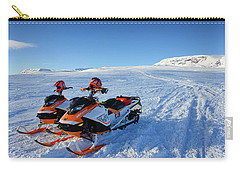 Carry-all Pouch featuring the photograph Snowmobiles In Iceland In Winter by Matthias Hauser