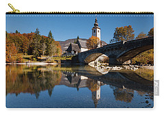 Carry-all Pouch featuring the photograph St. John The Baptist On The Lake Bohinj by Davor Zerjav
