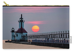 Carry-all Pouch featuring the photograph St. Joseph Lighthouse At Sunset by Adam Romanowicz