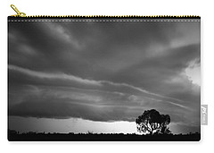 Carry-all Pouch featuring the photograph Storm Passing Over Solitary Tree In The Desert by Keiran Lusk