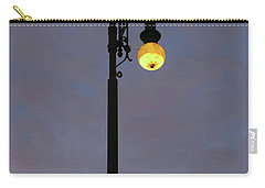 Carry-all Pouch featuring the photograph Street Lamp Shining At Dusk by Michal Boubin