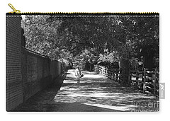 Carry-all Pouch featuring the photograph Stroll To Store by Eric Liller