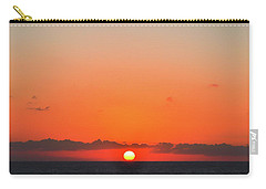 Sun Balancing On The Horizon Carry-all Pouch