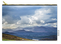 Carry-all Pouch featuring the photograph Sun Rays Piercing Through The Clouds Touching The Irish Landscap by Semmick Photo
