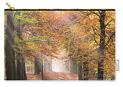 Sunbeams In A Forest In Autumn Carry-all Pouch by IPics Photography