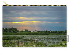 Sunrays On The Wetlands Carry-all Pouch by Tom Claud