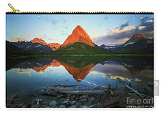 Carry-all Pouch featuring the photograph Sunrise At Many Glaciers by Craig J Satterlee