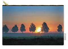 Carry-all Pouch featuring the photograph Sunrise Behind The Cedars by Lori Coleman