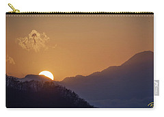 Carry-all Pouch featuring the photograph Sunset Over Asia  by Rikk Flohr