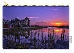 Sunset Over Hungryland Wildlife Management Area Carry-all Pouch by Justin Kelefas
