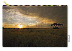 sunset over the Serengeti plains Carry-all Pouch