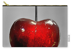 Carry-all Pouch featuring the photograph Suspended Cherry by Suzanne Stout