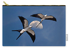 Swallow Tail Kites In Flight Under Moon Carry-all Pouch by Justin Kelefas