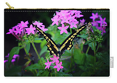 Carry-all Pouch featuring the photograph Swallowtail Butterfly Rests On Pink Flowers by Toni Hopper