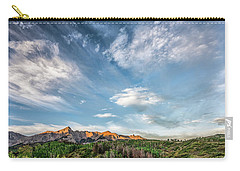 Carry-all Pouch featuring the photograph Sweeping Clouds by Jon Glaser