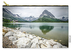Carry-all Pouch featuring the photograph Swiftcurrent Lake by Margaret Pitcher