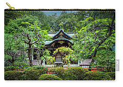 Carry-all Pouch featuring the photograph Temple In The Rain by Rikk Flohr