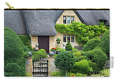 Carry-all Pouch featuring the photograph Thatch Roof Cottage Home by Brian Jannsen