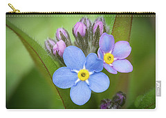 Carry-all Pouch featuring the photograph The First Blossom Of The Forget Me Not by William Lee