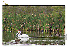 Carry-all Pouch featuring the photograph The Pelican And The Ducklings by Alyce Taylor