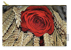 Carry-all Pouch featuring the photograph The Red Rose On A Bed Of Wheat by Diana Mary Sharpton