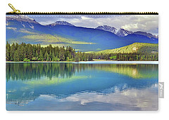 Carry-all Pouch featuring the photograph The Rockies Reflected In Lake Annette by Tara Turner