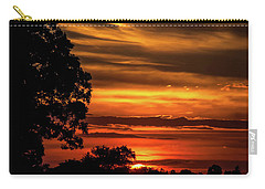 Carry-all Pouch featuring the photograph The Setting Sun by Mark Dodd