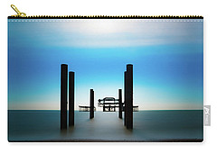Carry-all Pouch featuring the photograph The West Pier Ruins In Winter Light by Chris Lord