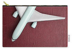 Carry-all Pouch featuring the photograph Toy Airplane Over Red Book Cover by Edward Fielding
