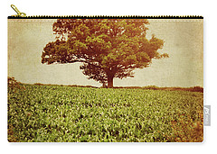 Carry-all Pouch featuring the photograph Tree On Edge Of Field by Lyn Randle