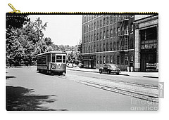 Carry-all Pouch featuring the photograph Trolley With Packard Building  by Cole Thompson