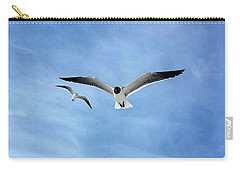 Two Seagulls Against A Blue Sky Carry-all Pouch by Jeanne Forsythe