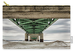 Carry-all Pouch featuring the photograph Under Mackinac Bridge Winter by John McGraw