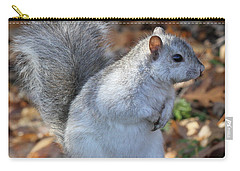 Carry-all Pouch featuring the photograph Unusual White And Gray Squirrel by Doris Potter