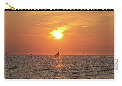 Us Flag Floating At Sunrise Carry-all Pouch by Robert Banach