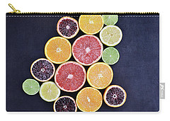 Carry-all Pouch featuring the photograph Variety Of Citrus Fruits by Stephanie Frey