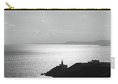 Carry-all Pouch featuring the photograph View Of Howth Head With The Baily Lighthouse In Black And White by Semmick Photo
