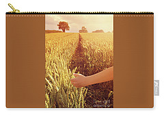 Carry-all Pouch featuring the photograph Walking Through Wheat Field by Lyn Randle