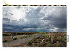 Carry-all Pouch featuring the photograph Watching The Storms Roll By by Margaret Pitcher