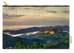 Carry-all Pouch featuring the photograph Looking Glass Rock Sunrise Between The Clouds Blue Ridge Parkway by Reid Callaway