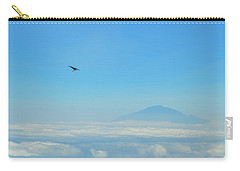 Carry-all Pouch featuring the photograph White-necked Raven With Twig Soaring Over Mount Meru by Jeff at JSJ Photography