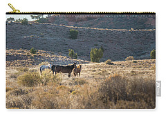 Carry-all Pouch featuring the photograph Wild Horses In Monument Valley by Jon Glaser